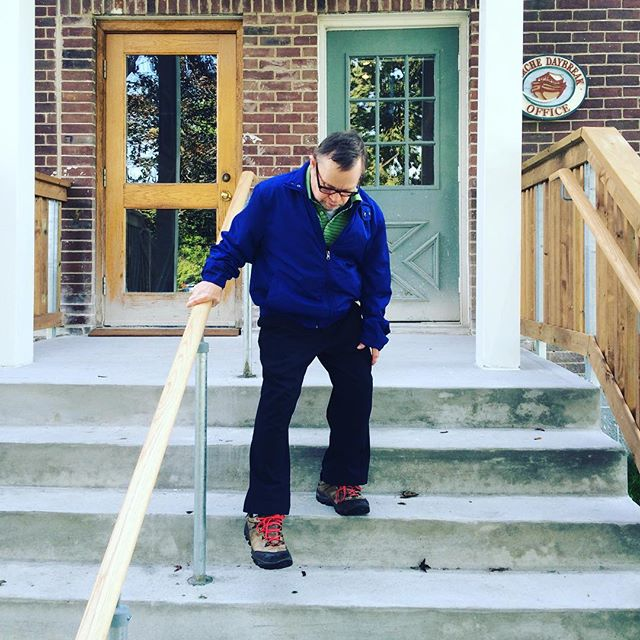 Gord Henry, one of the founding members of L'Arche Daybreak uses the new railing at the Big House Office building, installed in 2015