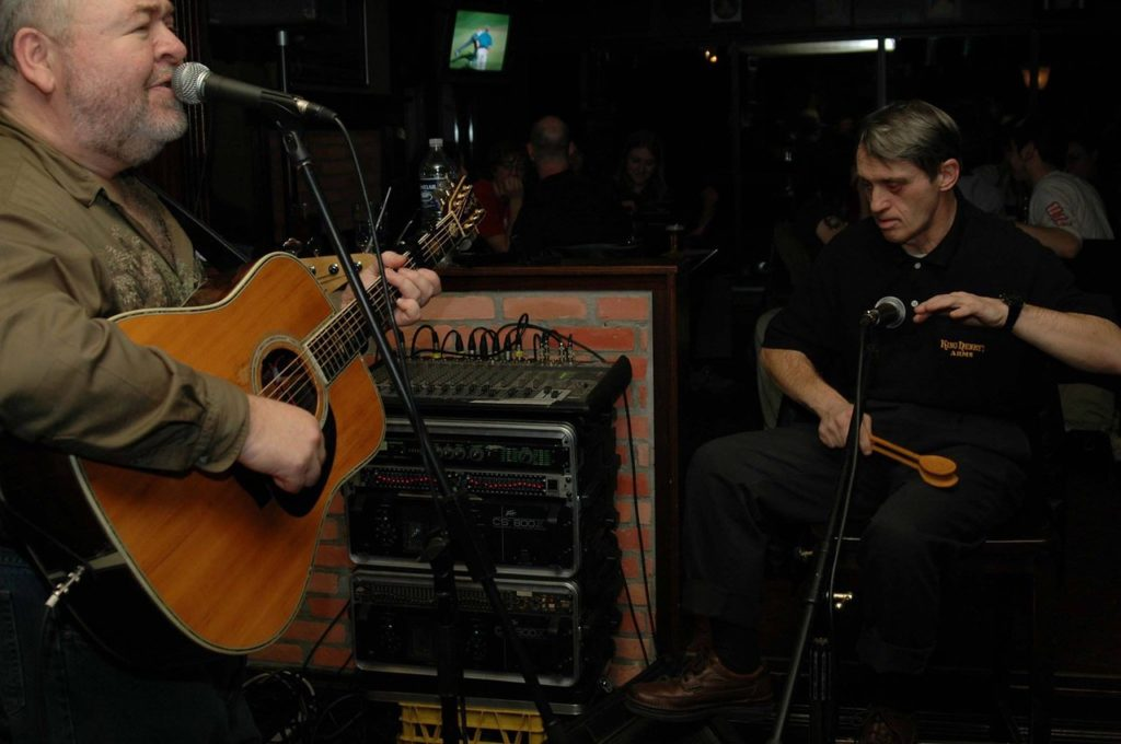 Lou Moore, who welcomed John to play the spoons with his band at local pubs, was there to open the service with song in a way that John would have loved.